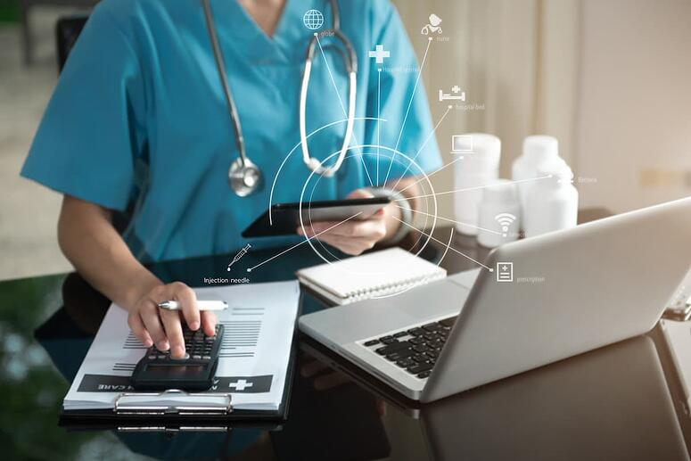 Physician checking patient payment